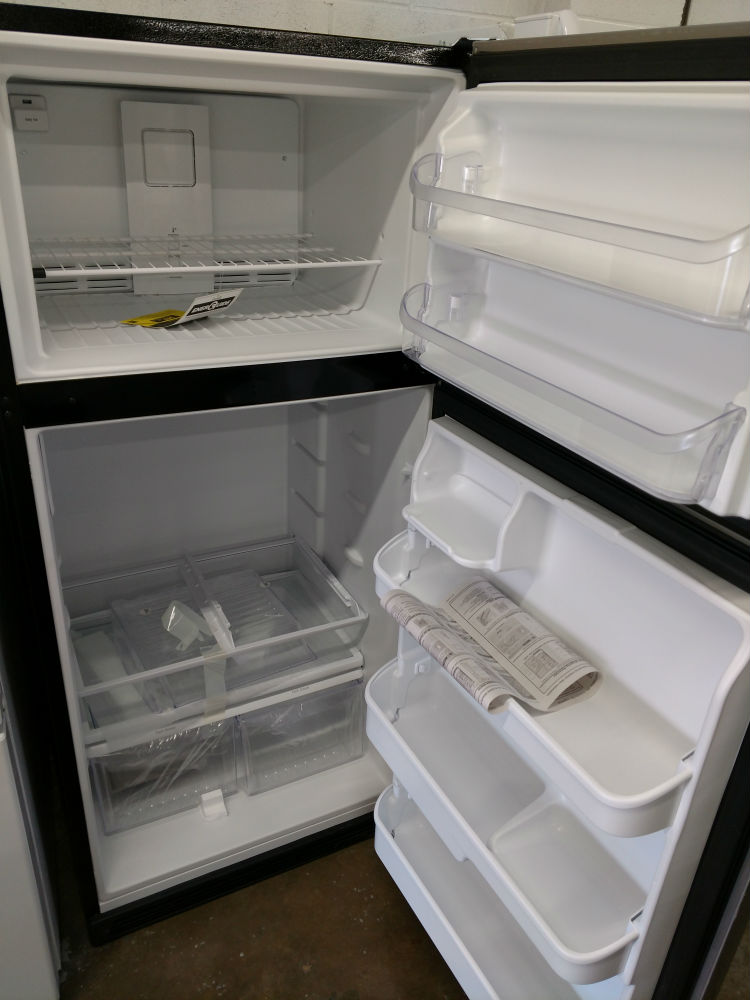 Whirlpool white side by side refrigerator  interior